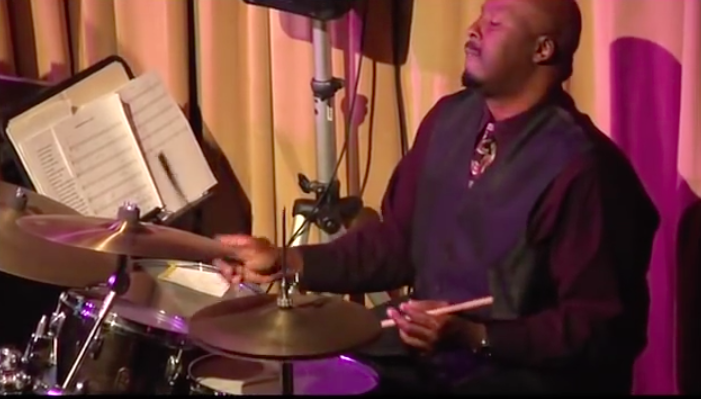 Drummer, Rob Rhodes, on stage with Professor RJ Ross and The University of Soul.